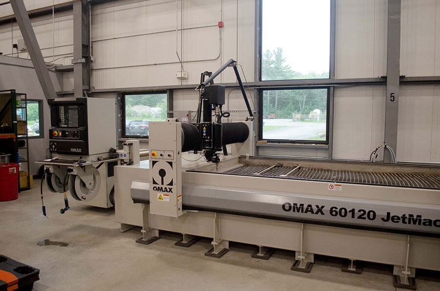 OMAX 60120 JetMachining waterjet cutting table in contract manufacturing facility